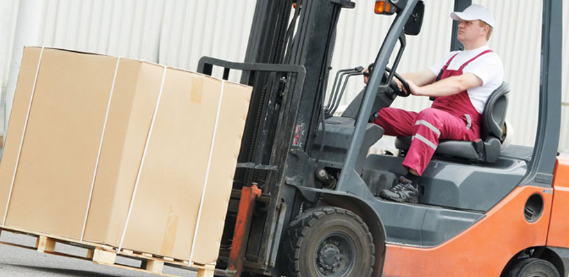 man on a fork lift