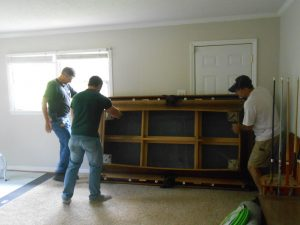 How to Disassemble a Pool Table for Moving Long Distance